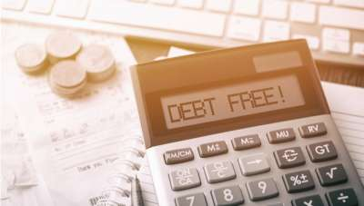 A calculator displaying debt free